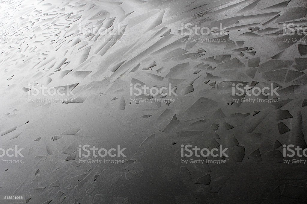 Ice on river broken in to geometrical angular shape pieces stock photo