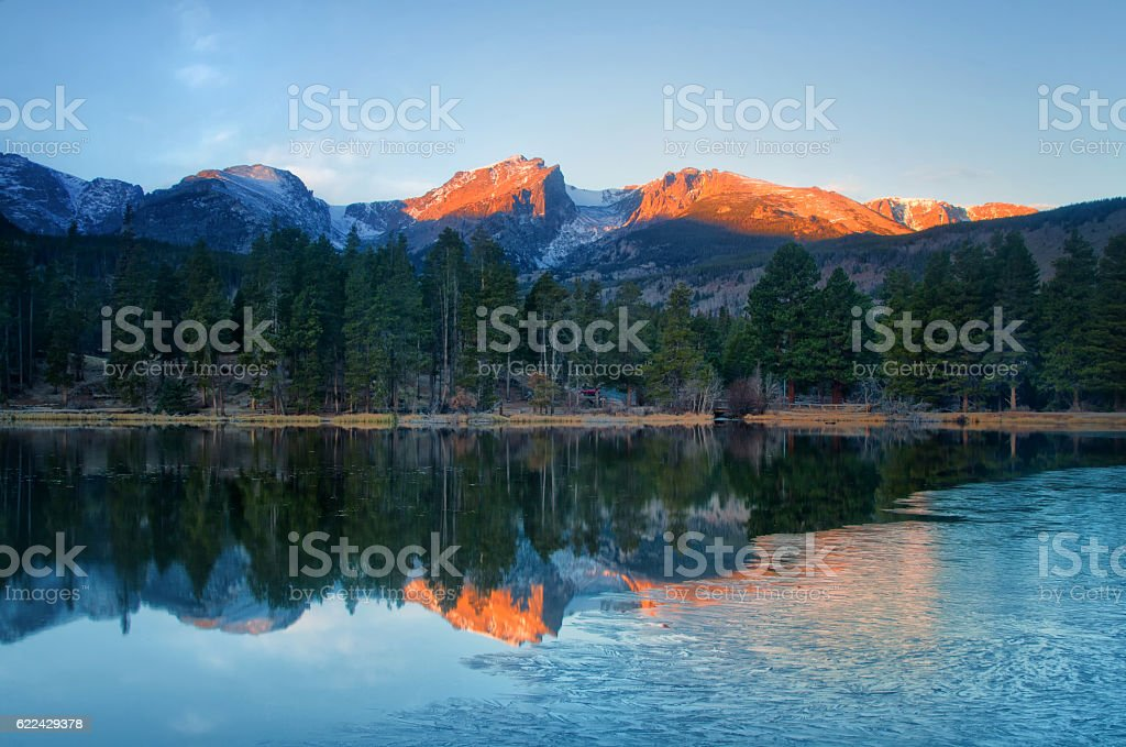 Ice on Sprague Lake, Rocky Mountain National Park at sunrise stock photo