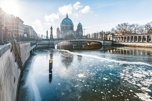 ice on spree river with berlin cathedral