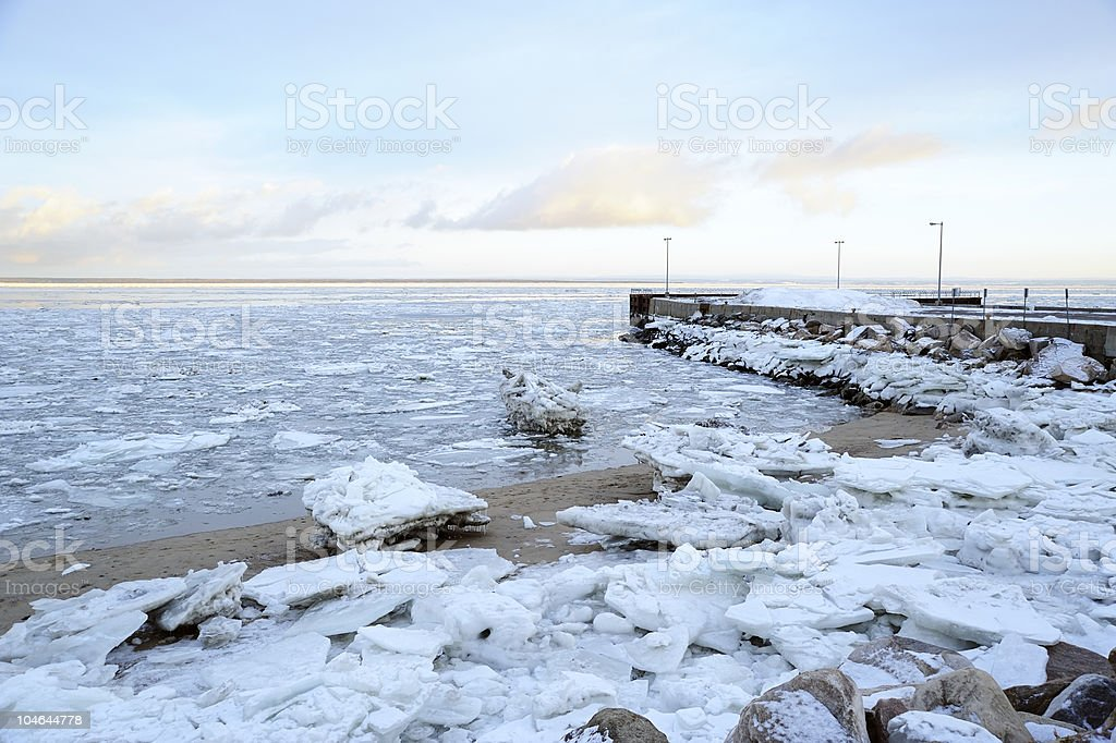 Ice on the beach and quay royalty-free stock photo