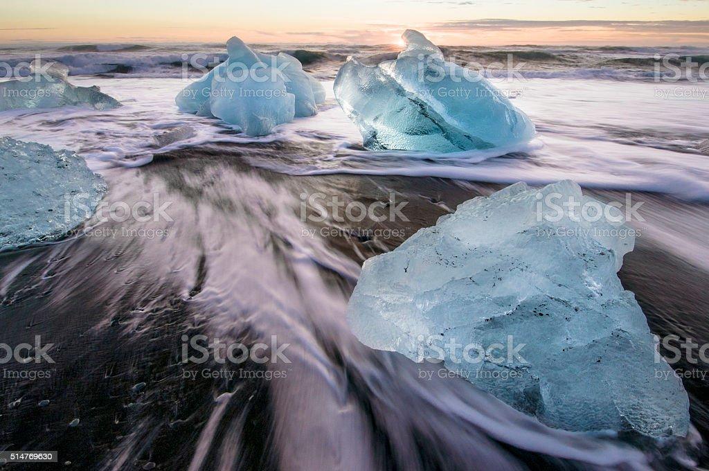 Ice on the black volcanic beach, Jokulsarlon glacier lagoon, Iceland. stock photo