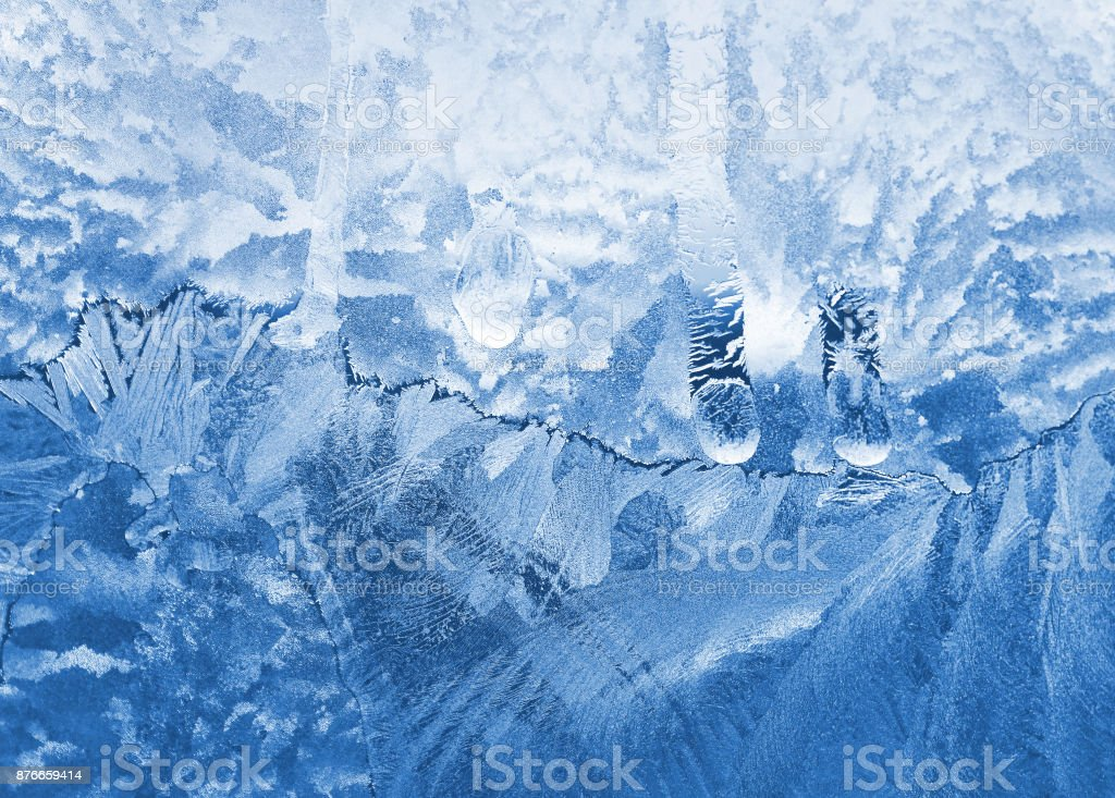 Ice pattern close-up on glass stock photo