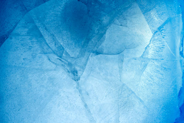 Ice Closeup of cracked blue ice ice stock pictures, royalty-free photos & images