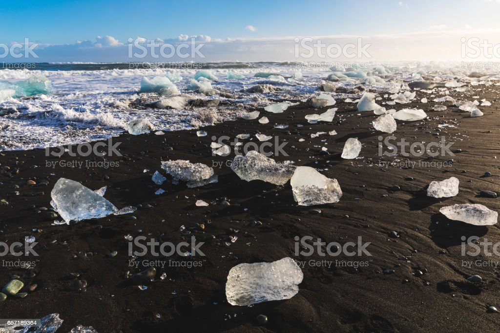 Ice pieces on black sand beach in Iceland stock photo
