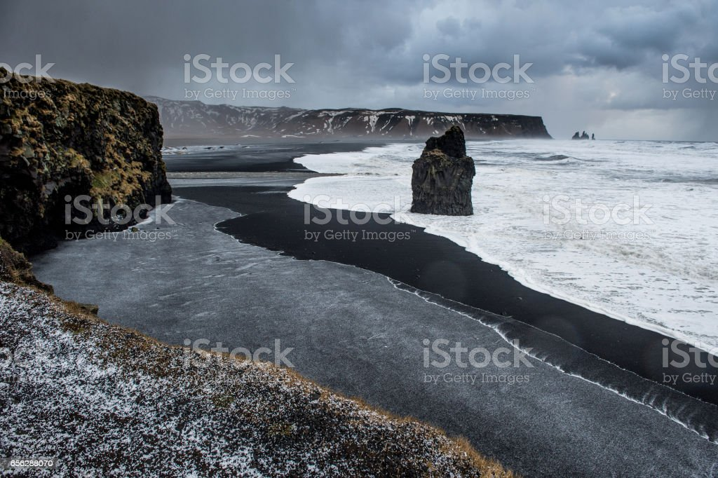 Ice rain in hail in Kirkjufjara black beach Iceland stock photo