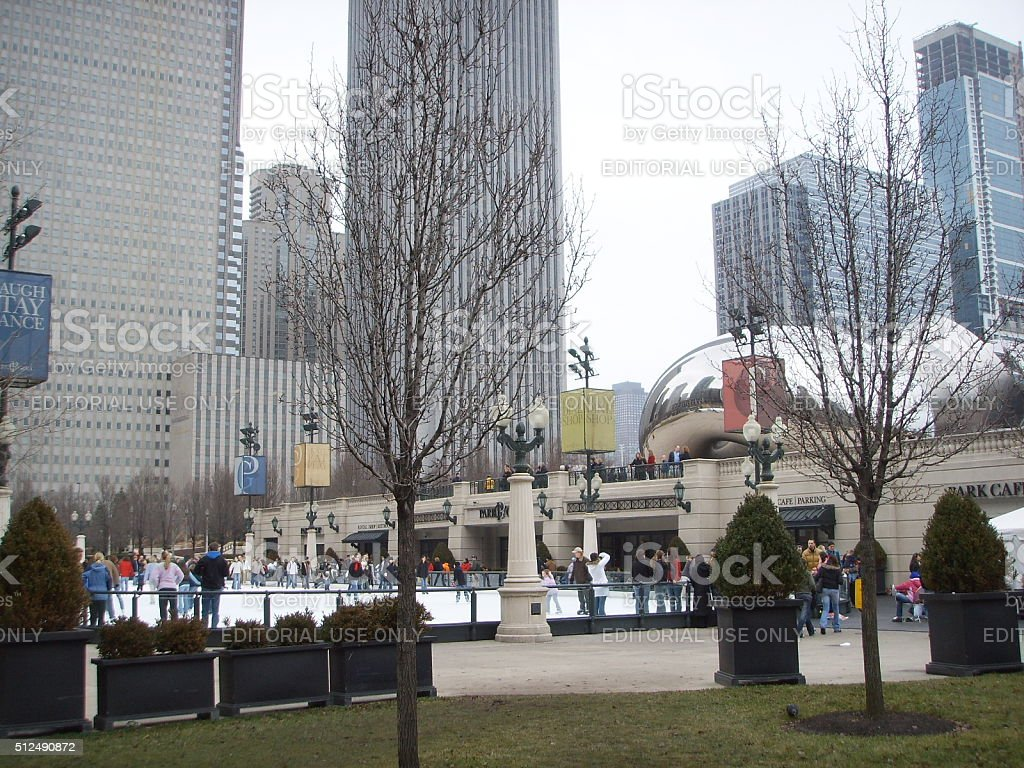 Ice Rink and Cloud Gate in Millennium Park in Chicago. stock photo