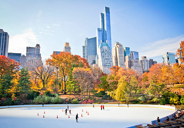 Ice rink Ice skaters having fun in New York Central Park in fall ice skating stock pictures, royalty-free photos & images