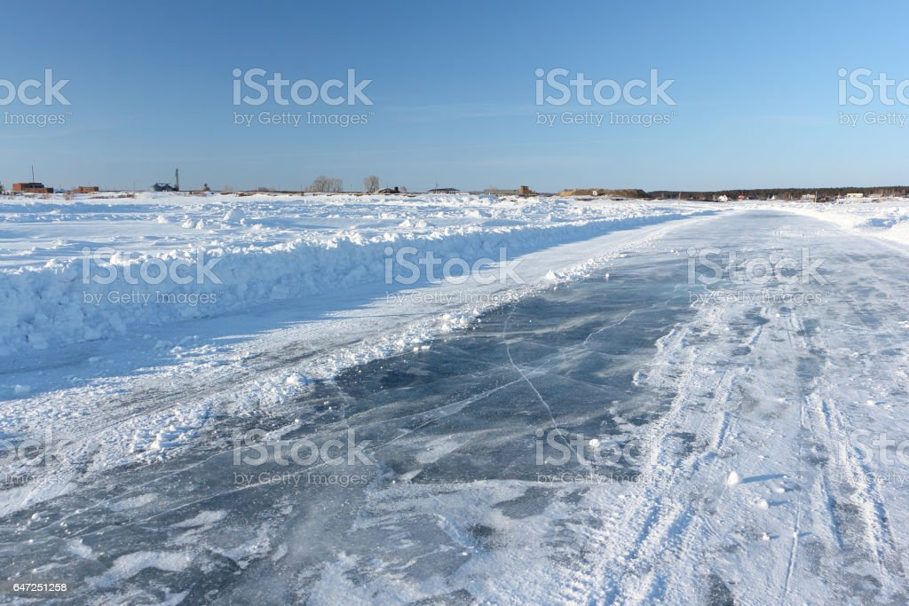 Ice road on a frozen reservoir in the winter stock photo