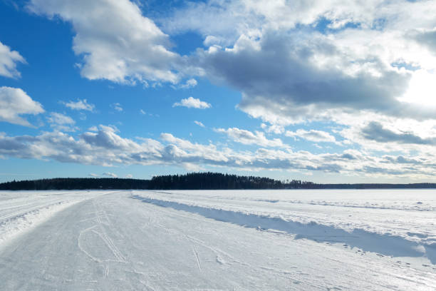Ice road on frozen lake in winter stock photo