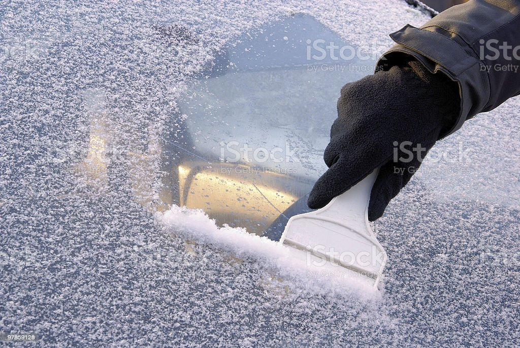 ice scraping royalty-free stock photo