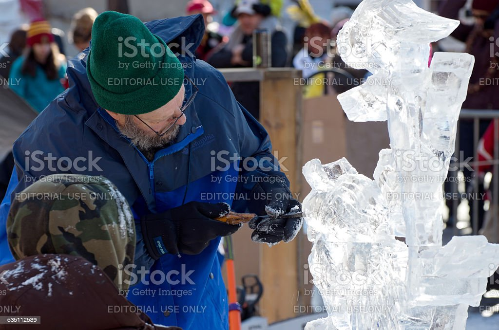 Ice Sculptor and Assistant at Winter Carnival stock photo
