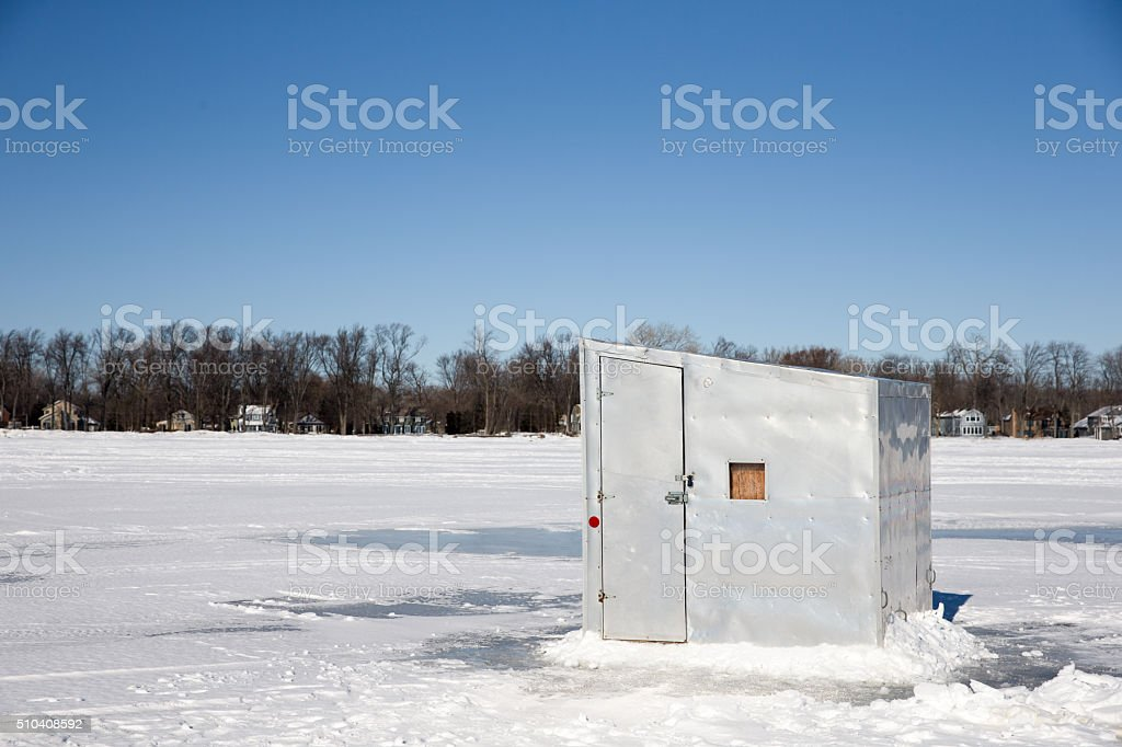 Ice Shanty on a Frozen Lake stock photo