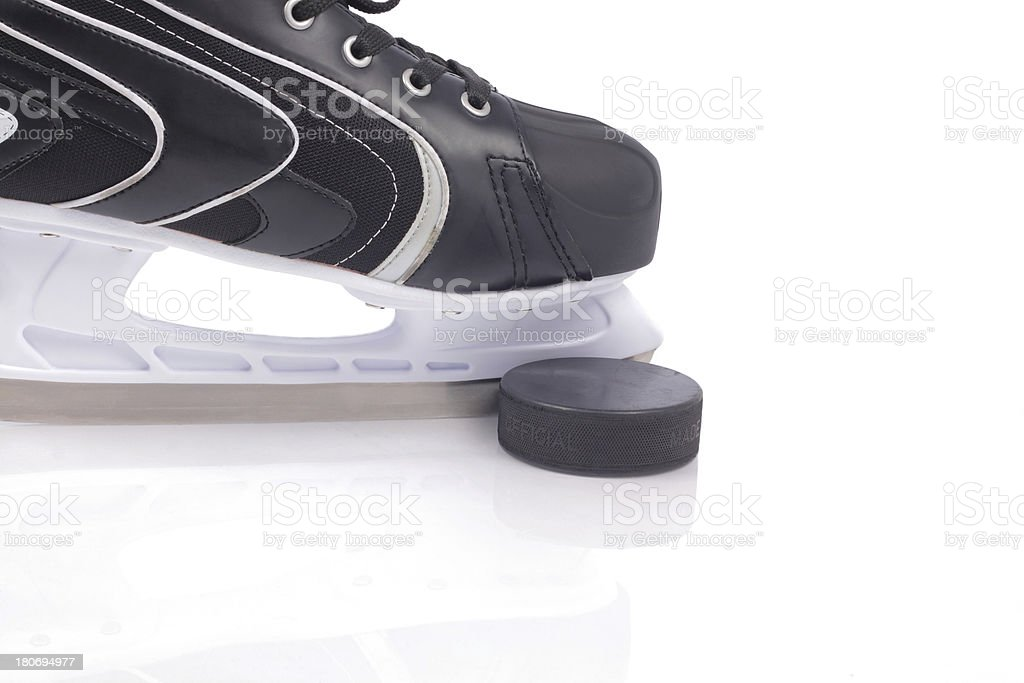 Ice skate and puck royalty-free stock photo