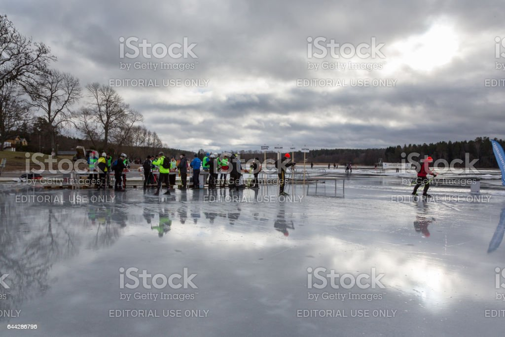 Ice skaters and voluntary workers at a rest area on the ice. royalty-free stock photo