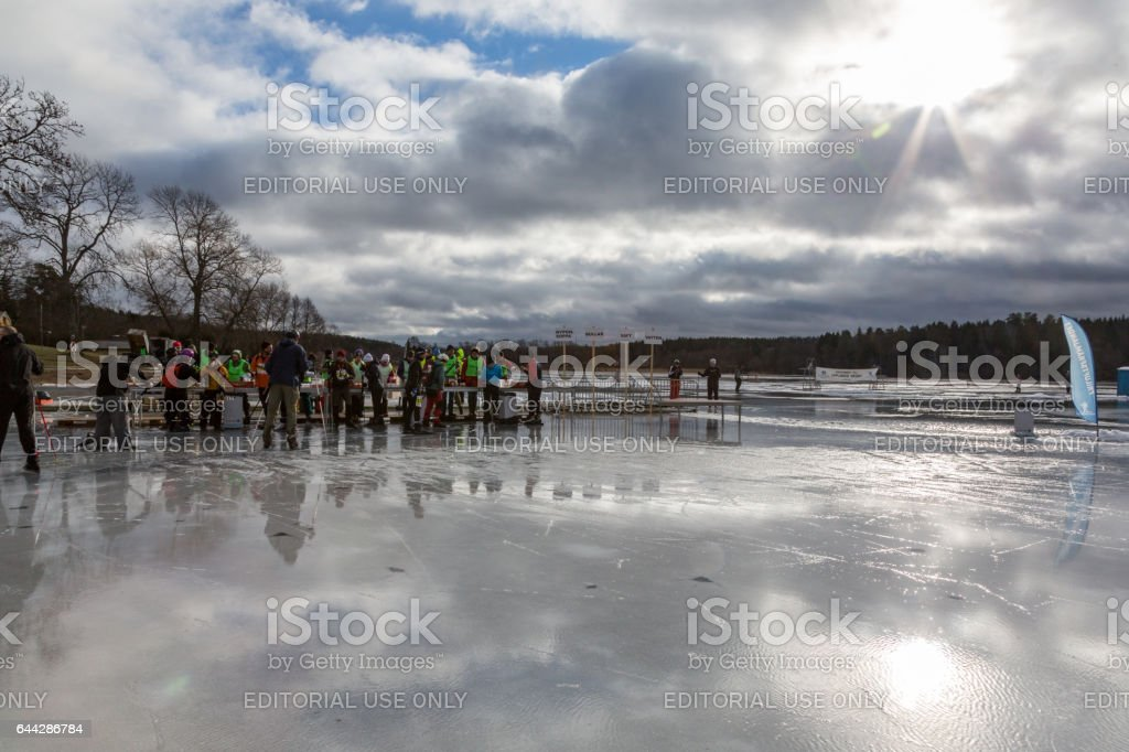 Ice skaters and volunteers at a resting area on the ice. royalty-free stock photo