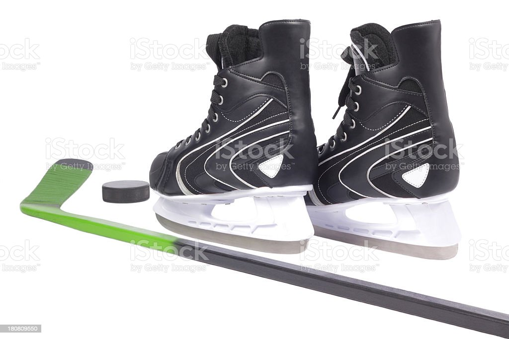 Ice skates, hockey stick and puck royalty-free stock photo