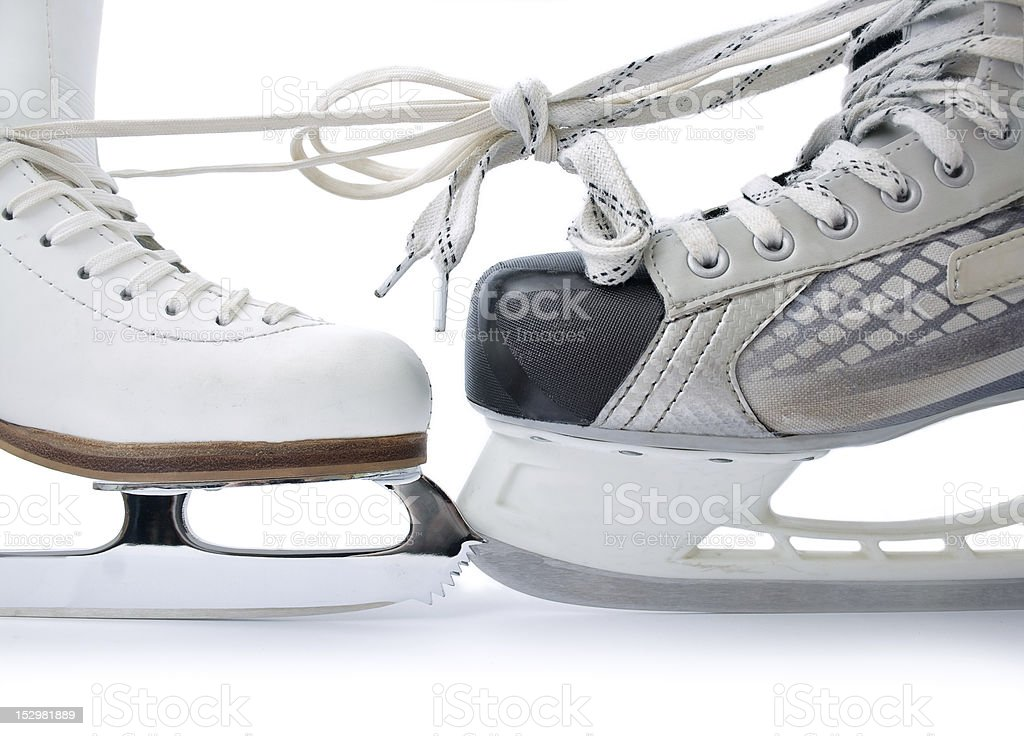 Ice skates tied against each other stock photo