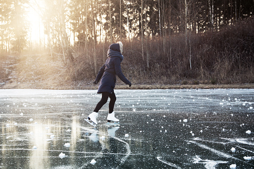 Ice skating on the frozen lake