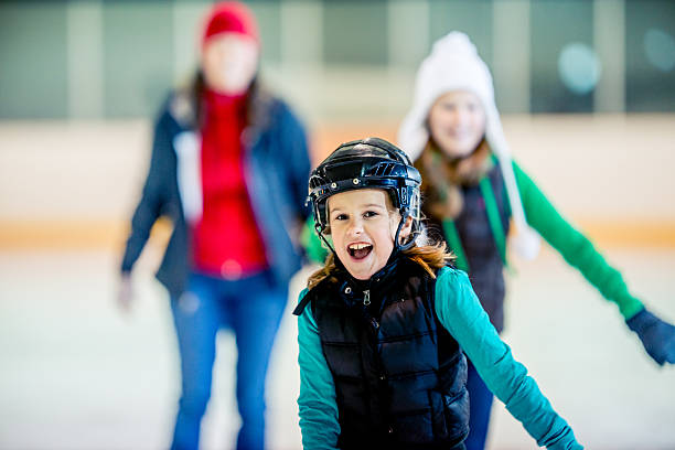 Ice skating Having a good time at an ice skating arena. ice skating stock pictures, royalty-free photos & images