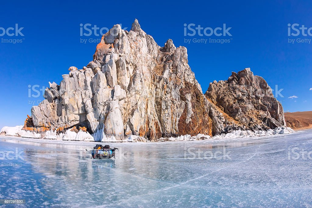 Ice sledge, ski poles and backpack before Shaman Rock stock photo