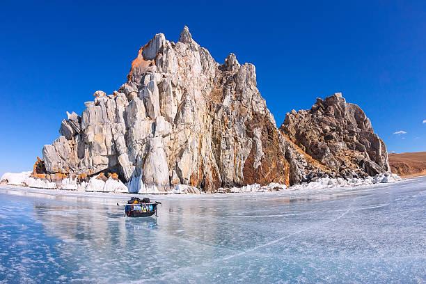 Ice sledge, ski poles and backpack before Shaman Rock stock photo