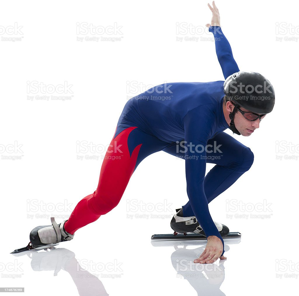 Ice speed skater in low start position stock photo