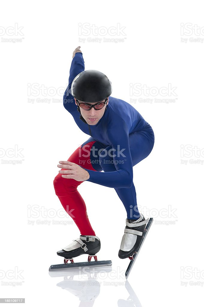 Ice speed skater in starting position stock photo