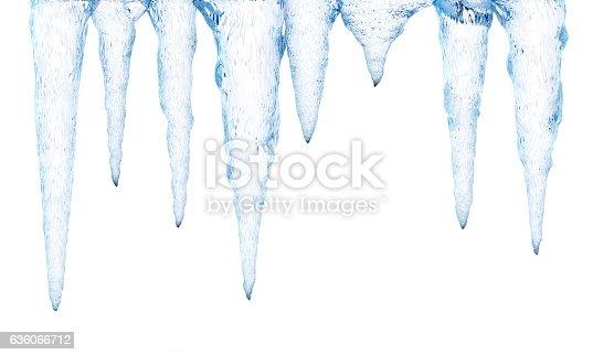 Sharp ice stalactiles isolated on white.
