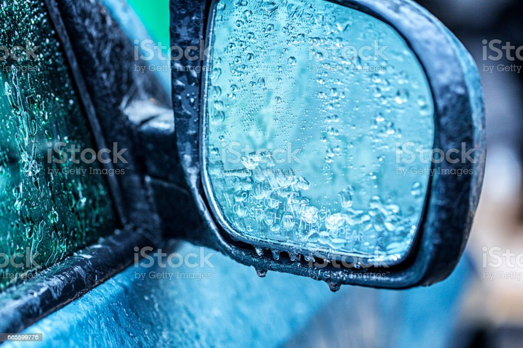 Ice Storm Freezing Rain Dripping From Car Rear-View Mirror stock photo