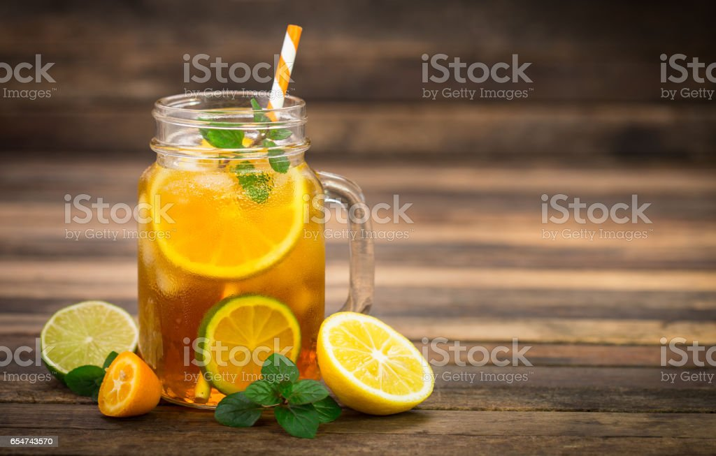 Ice tea with lemon, lime and mint