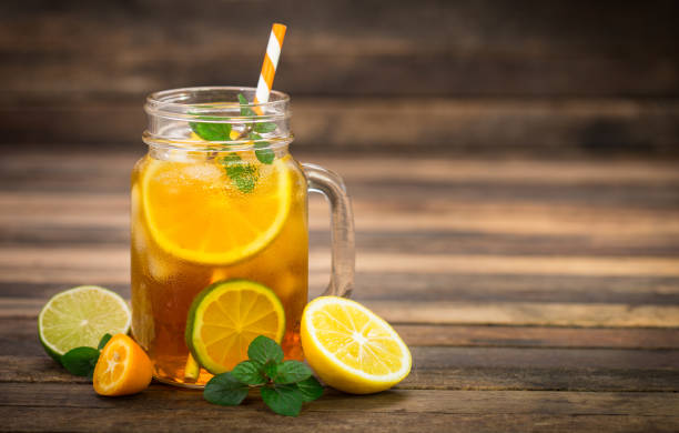 Ice tea with lemon, lime and mint stock photo