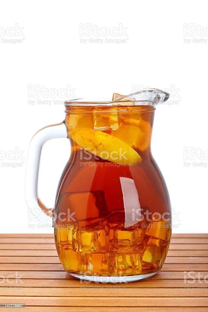 Ice tea with lemon pitcher stock photo