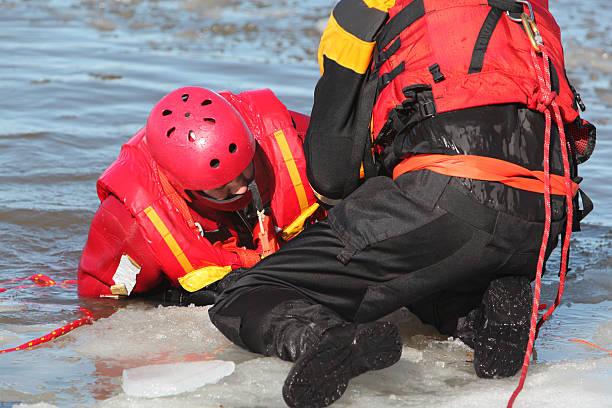 Ice water rescuers stock photo
