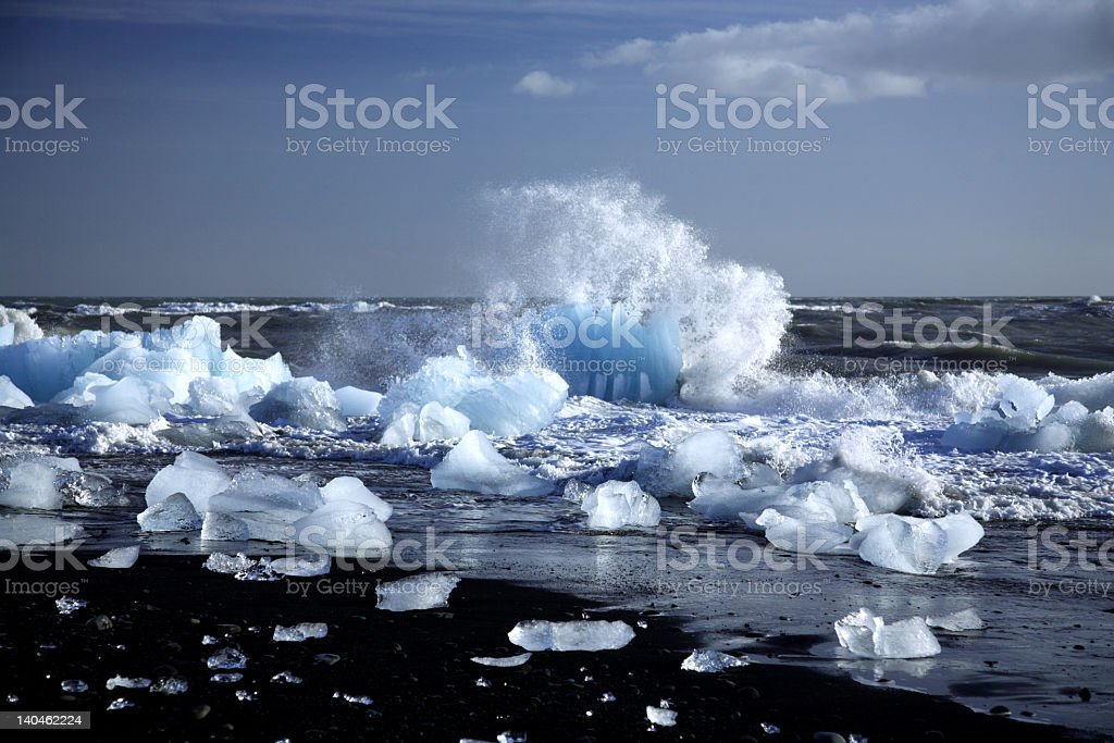 Iceberg being broken by the waves on the beach Iceland royalty-free stock photo