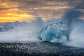 Iceberg block shape on the Jokulsarlong lava beach during sunrise