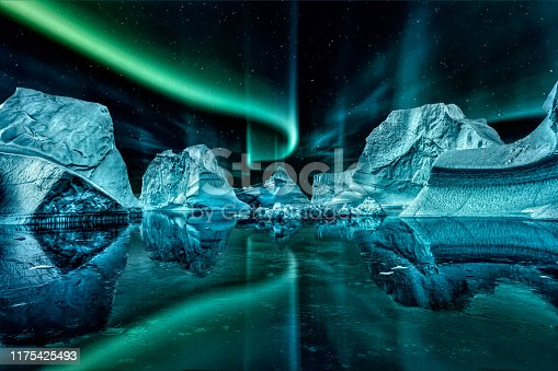 iceberg floating in greenland fjord at night with green northern lights.