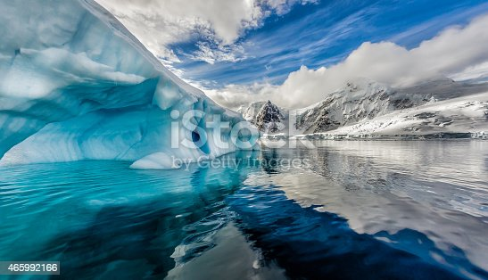 /Iceberg floats in Andord Bay on Graham Land, Antarctic in November