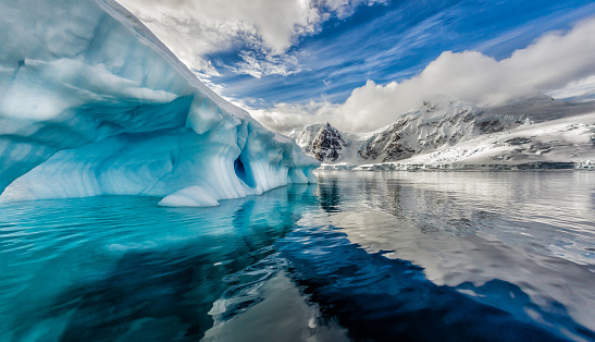 Iceberg Floats In Andord Bay On Graham Land Antarctica Stock Photo - Download Image Now