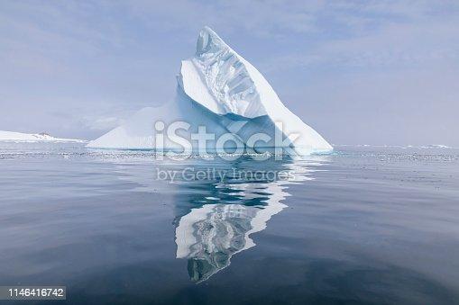 Iceberg reflected in the ocean of Errera Channel, Antarctic Peninsula