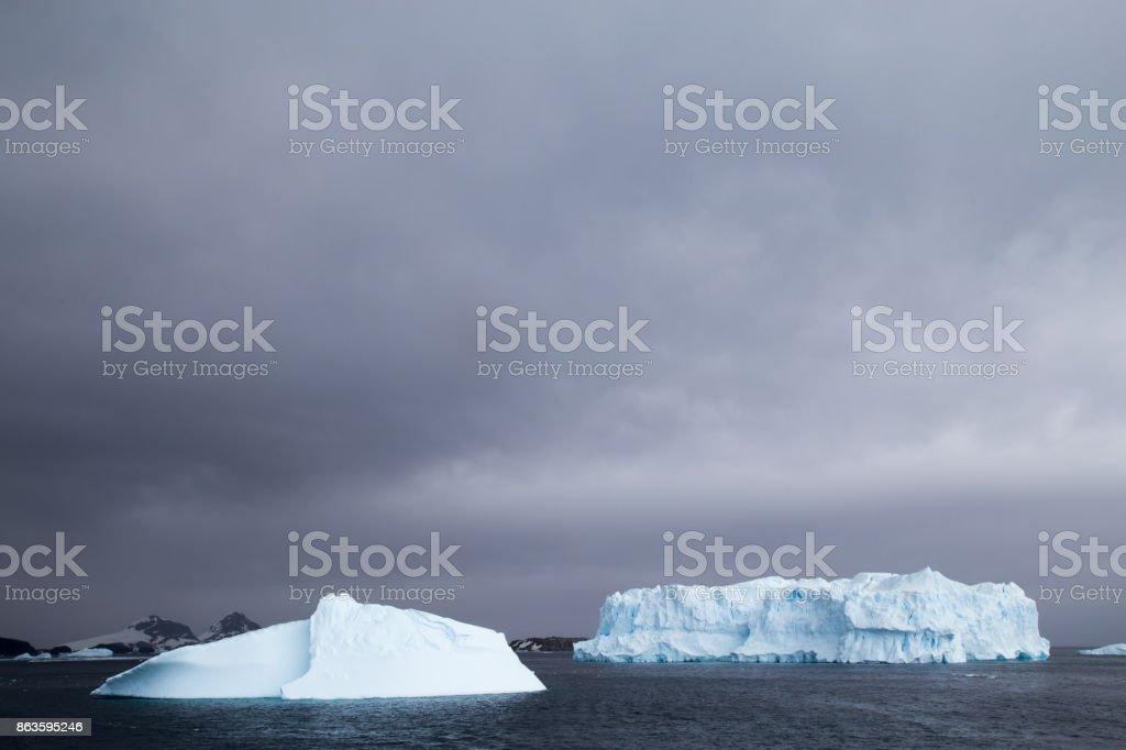 Iceberg in Cierva Cove, Antarctic Peninsula during low light and dark cloud conditions. stock photo