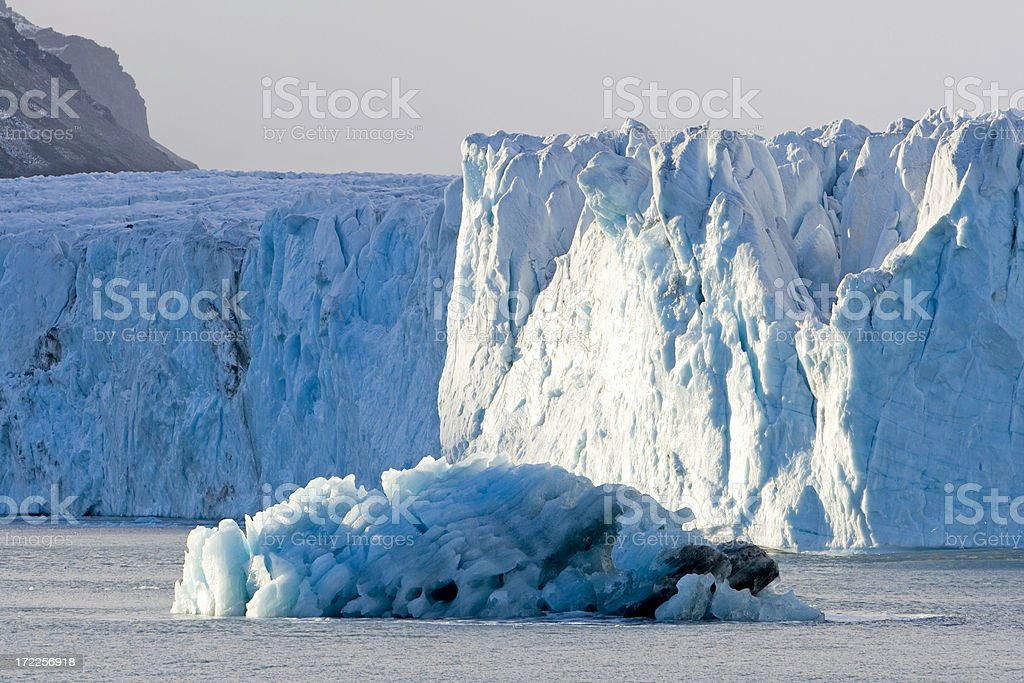 Iceberg in front of antarctic glacier royalty-free stock photo