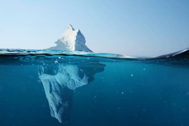 Iceberg in the ocean with a view under water. Crystal clear water. Hidden Danger And Global Warming Concept Iceberg in the ocean with a view under water. Crystal clear water. Hidden Danger And Global Warming Concept environmental damage stock pictures, royalty-free photos & images