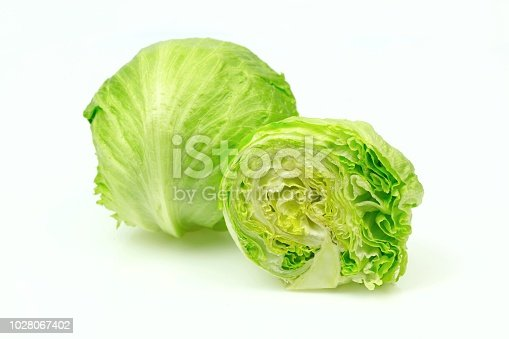 Iceberg lettuce and one cut half, on white background.