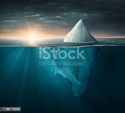 Plastic bag in the ocean looking like an iceberg, with copy space