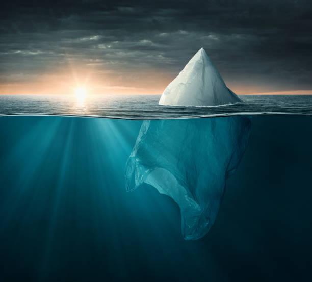 iceberg made of plastic bag in the ocean - iceberg imagens e fotografias de stock