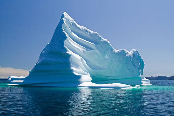 iceberg, newfoundland, trinity bay, canada - iceberg stock photos and pictures