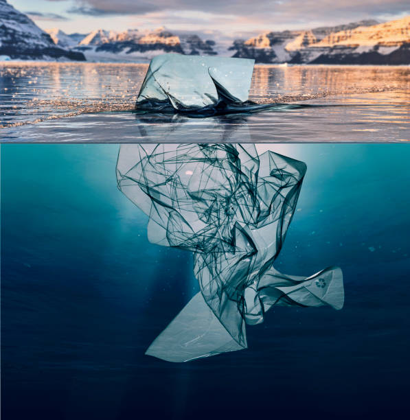iceberg of garbage plastic floating in ocean with greenland back - ocean plastic stock pictures, royalty-free photos & images