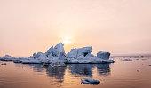 Iceberg near the coast of Greenland in the sunset.