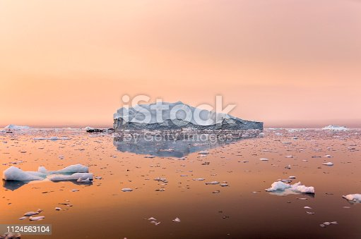 Iceberg in Greenland in the sunset, beautiful nature.