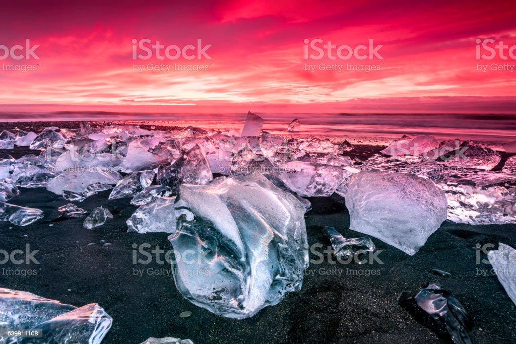 Iceberg on Jokulsarlon glacial lagoon beach stock photo